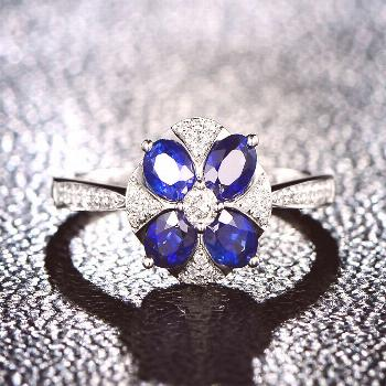 Blue flower solitaire ring  White gold, sapphires and diamonds