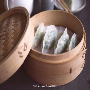 Dim Sum Pork and Chives Crystal Dumplings.Steamed savory juicy pork and chives filling enclosed in