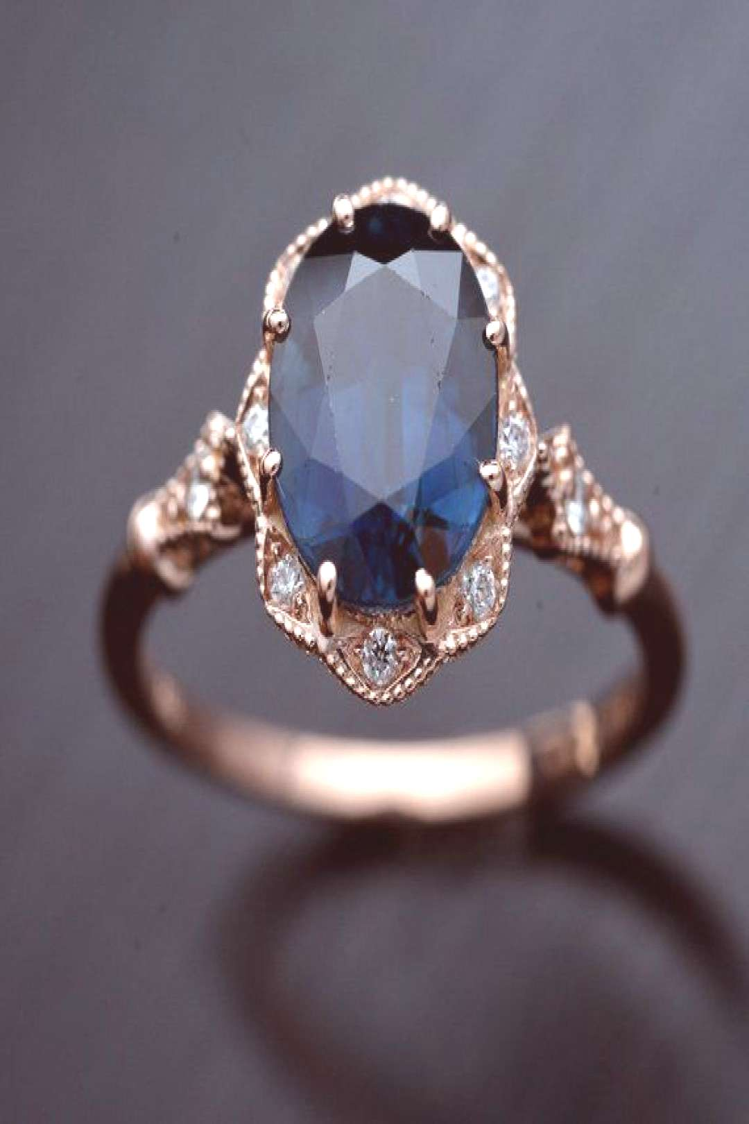Halo engagement ring with a natural deep blue Australian sapphire vintage style with natural diamon