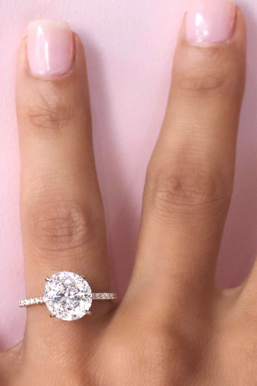 Oval diamond engagement ring set with two-tone metal (18K Rose Gold amp Platinum). This ring, known a
